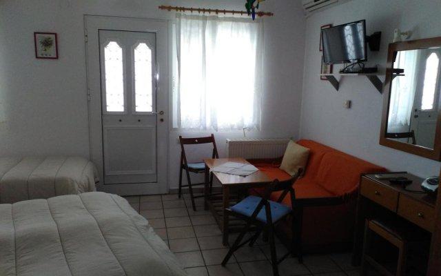 Апартаменты Anthos Apartments комната для гостей