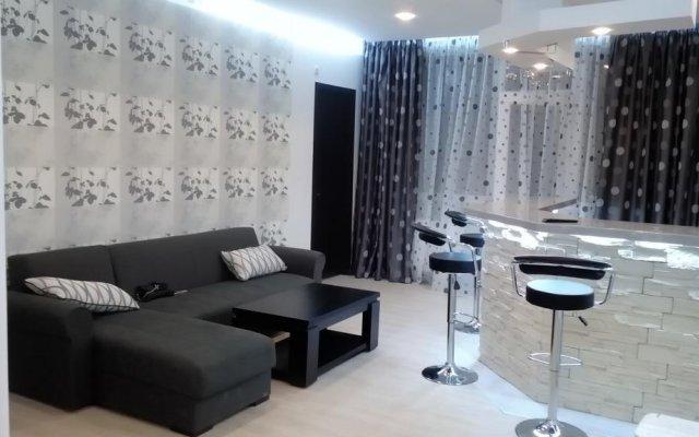 Апартаменты La'Tuka Apartments комната для гостей