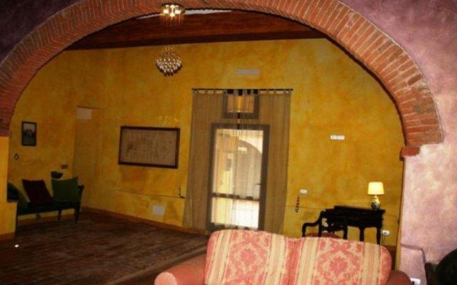 Отель Agriturismo I Poggi Gialli Синалунга комната для гостей