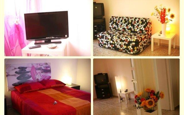 Апартаменты Gold Gladiator Apartment комната для гостей