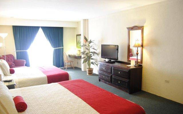 Отель Apart Hotel La Cordillera Гондурас, Сан-Педро-Сула - отзывы, цены и фото номеров - забронировать отель Apart Hotel La Cordillera онлайн комната для гостей