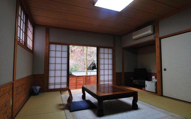 Отель Ryukeien Минамиогуни комната для гостей