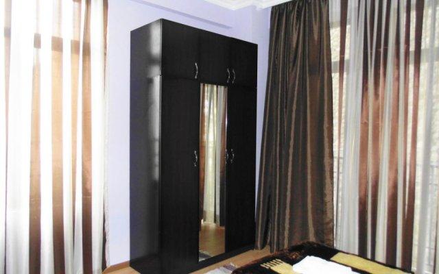 Апартаменты Welcome Inn комната для гостей