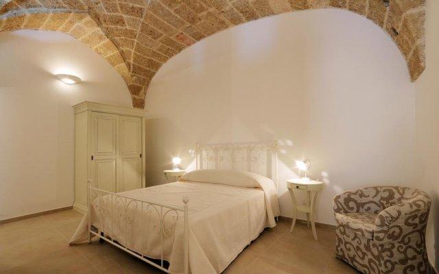 Отель Suite piazzetta villani Пресичче комната для гостей