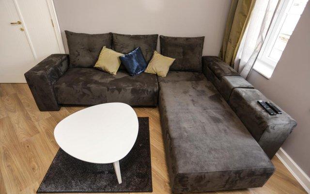Апартаменты Moment Boutique Apartment комната для гостей