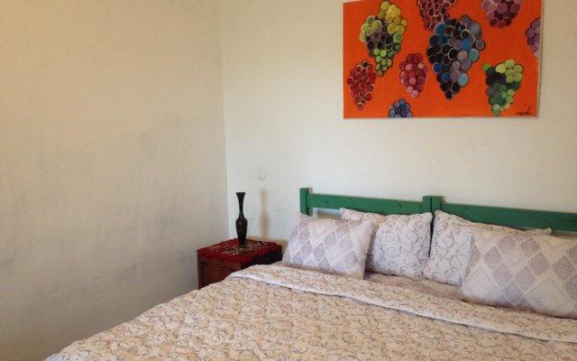 Отель Tegheniq Guesthouse Сагмосаван комната для гостей