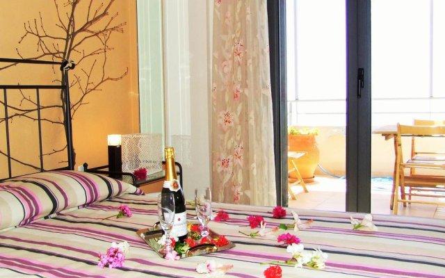Отель Anemos Luxury Villas комната для гостей