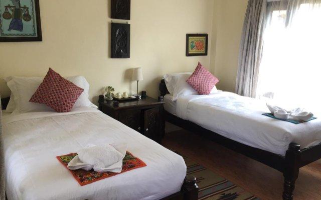 Отель Mingtang Garden Cottage 名堂花园度假屋 Непал, Покхара - отзывы, цены и фото номеров - забронировать отель Mingtang Garden Cottage 名堂花园度假屋 онлайн комната для гостей