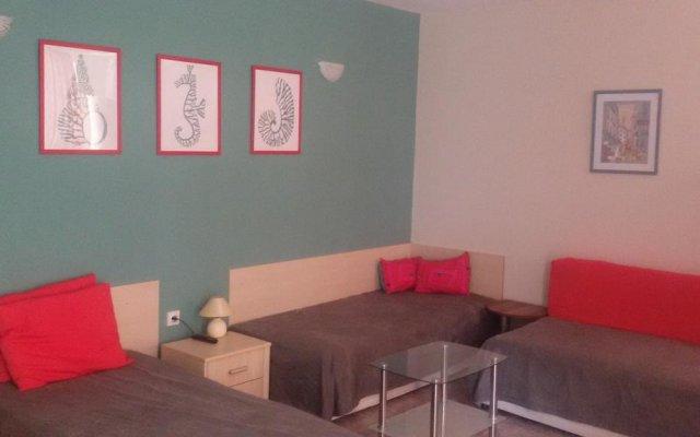Апартаменты Comfort Apartment Поморие комната для гостей