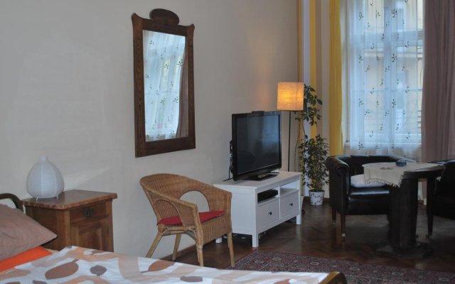 Апартаменты Apartment Pstrossova Прага комната для гостей