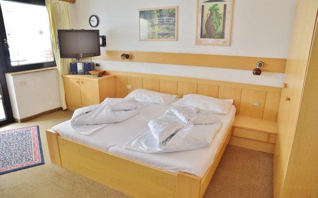 Отель Alpina Residence Стельвио комната для гостей