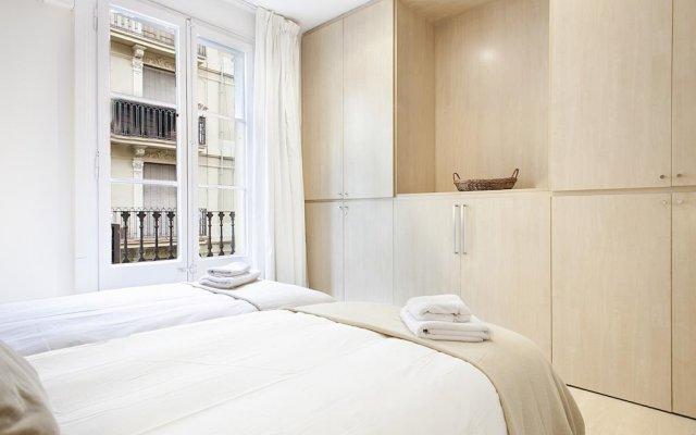 Апартаменты Habitat Apartments Barceloneta Барселона комната для гостей