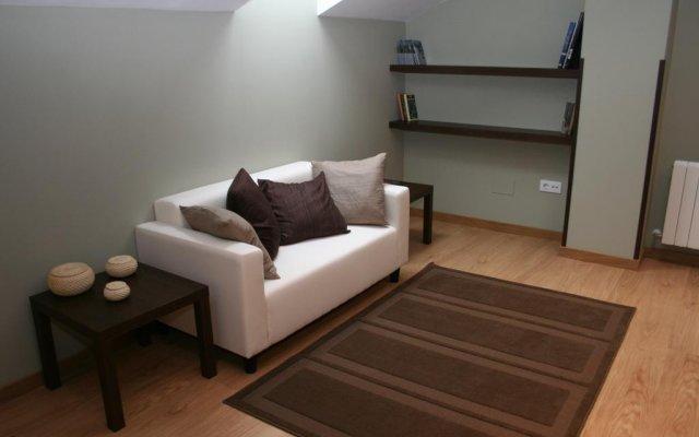 Отель Apartamentos El Regueirin 2 Кудильеро комната для гостей