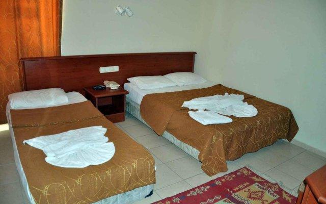 Отель Canlar Otel Сиде сейф в номере