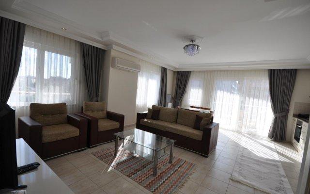 Апартаменты M.Tasdemir Apartment комната для гостей