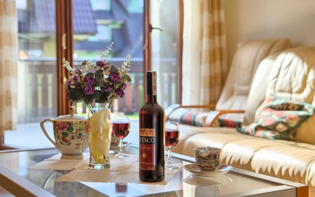 Отель VISITzakopane Rainbow Apartments Польша, Закопане - отзывы, цены и фото номеров - забронировать отель VISITzakopane Rainbow Apartments онлайн комната для гостей