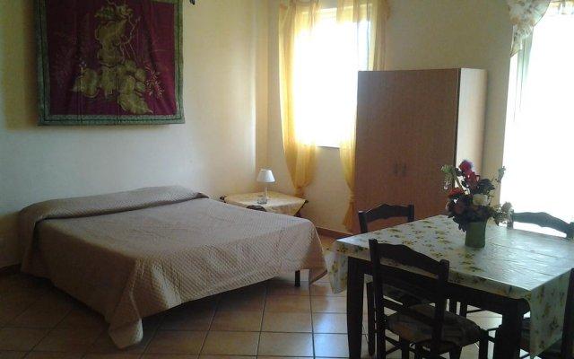 Отель Appartamento Sergio Порт-Эмпедокле комната для гостей