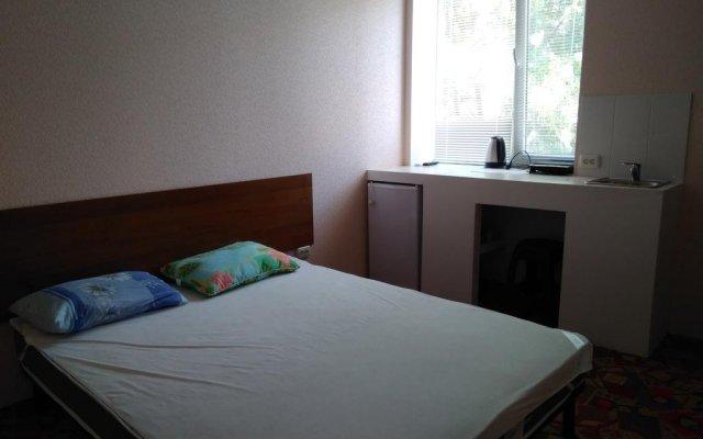 Отель Azov Guest House Бердянск комната для гостей