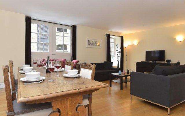 Апартаменты River Side Apartments комната для гостей