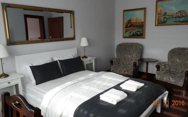 Отель Gosciniec Sarmata Польша, Познань - отзывы, цены и фото номеров - забронировать отель Gosciniec Sarmata онлайн комната для гостей