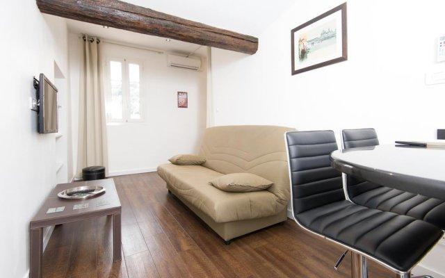 Апартаменты Studio Cassini комната для гостей