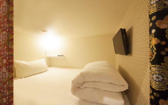 Отель Capsule and Sauna Oriental Япония, Токио - отзывы, цены и фото номеров - забронировать отель Capsule and Sauna Oriental онлайн комната для гостей