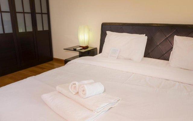 Апартаменты Emerald Palace - Serviced Apartment Паттайя комната для гостей