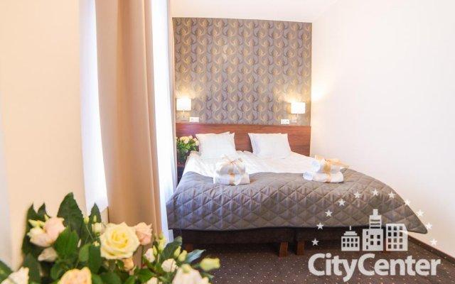 Отель City Center Rooms комната для гостей