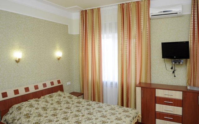 Hotel Naberzhnyi Бердянск комната для гостей