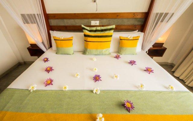 Отель Amba Ayurveda Boutique Hotel Шри-Ланка, Пляж Golden Mile - отзывы, цены и фото номеров - забронировать отель Amba Ayurveda Boutique Hotel онлайн комната для гостей