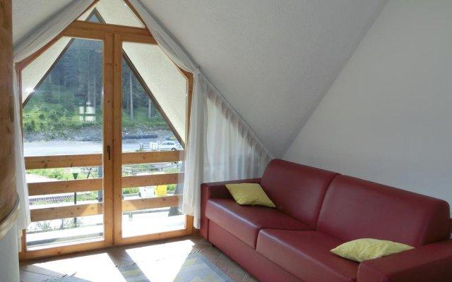 Отель Alberti - Condominio Villa Golf Пинцоло комната для гостей