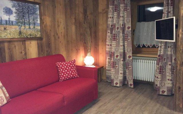 Отель Appartamento Villair Ла-Саль комната для гостей