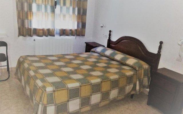 Отель Alojamiento CR Cuatro Caminos комната для гостей