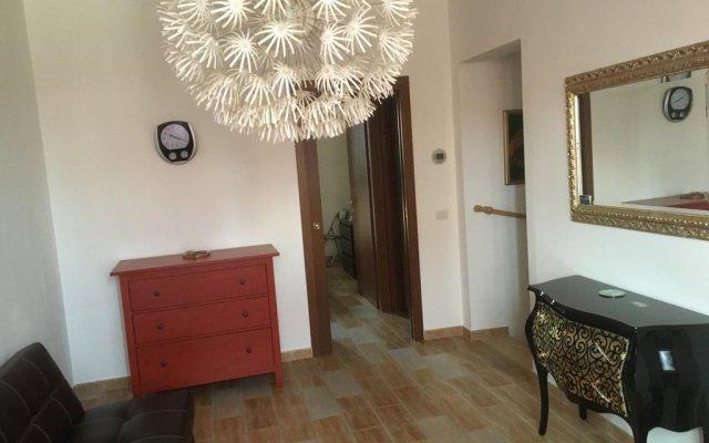 Отель Marco Turtu real estate Чивитанова-Марке комната для гостей