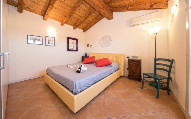 Отель Borgo Del Torchio B1 Манерба-дель-Гарда комната для гостей