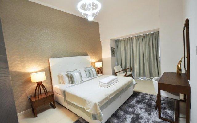 Отель Key One Homes - Cayan Tower комната для гостей
