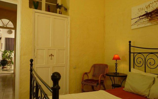 Отель Apartamentos Casa Rosaleda Испания, Херес-де-ла-Фронтера - отзывы, цены и фото номеров - забронировать отель Apartamentos Casa Rosaleda онлайн комната для гостей