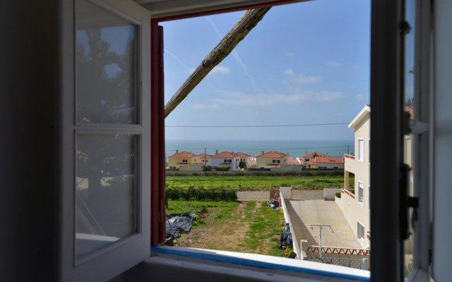 Отель Feels Like Home - Moinho do Mar near Ericeira комната для гостей