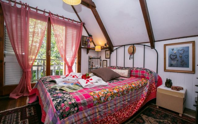 Отель Argegno Chalet Скиньяно комната для гостей