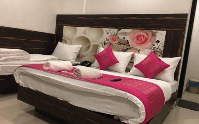 Hotel Sunrise Dx комната для гостей