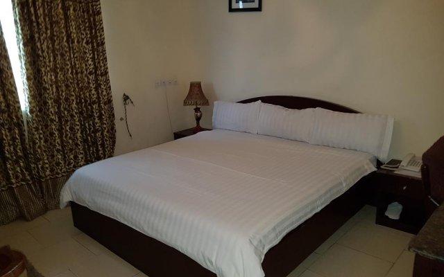 Отель Mangel Hotel And Suites Нигерия, Калабар - отзывы, цены и фото номеров - забронировать отель Mangel Hotel And Suites онлайн комната для гостей