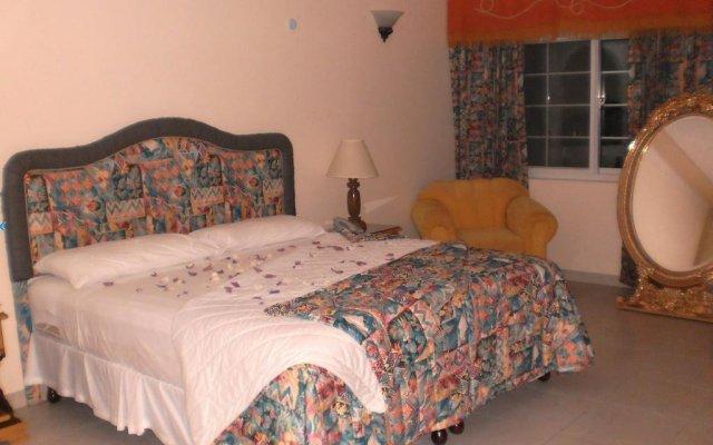 Отель Holiday Haven Ямайка, Ранавей-Бей - отзывы, цены и фото номеров - забронировать отель Holiday Haven онлайн комната для гостей