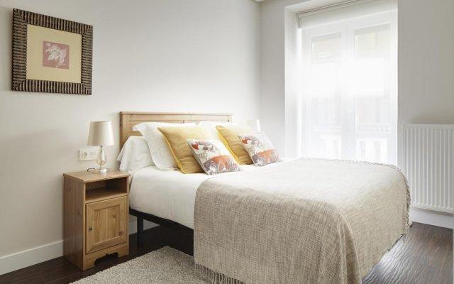 Отель Bermingham Apartment by FeelFree Rentals Испания, Сан-Себастьян - отзывы, цены и фото номеров - забронировать отель Bermingham Apartment by FeelFree Rentals онлайн комната для гостей