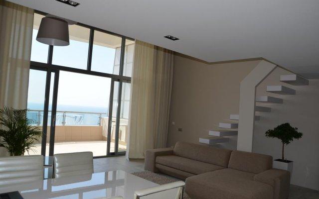 Апартаменты Apartment On Kurortnyy Ave Сочи комната для гостей