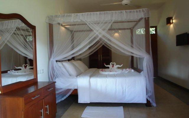 Отель Hasara Resort Бентота комната для гостей