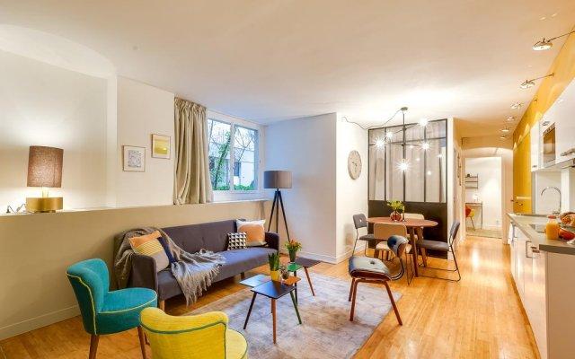 Апартаменты Sweet Inn Apartments - Rue Vaugirard комната для гостей