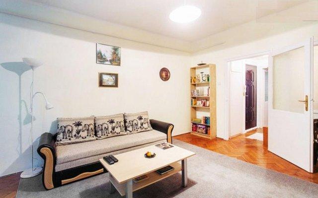 Апартаменты Toldy Apartment комната для гостей