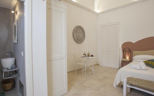 Отель Suite Nina Лечче комната для гостей