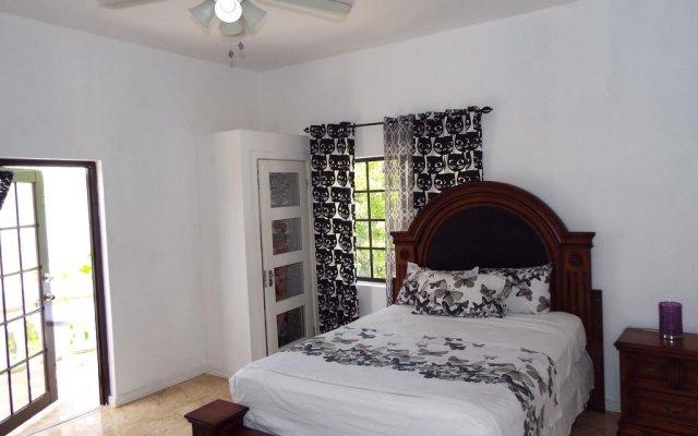Отель Little Savoy Guest House Ямайка, Ранавей-Бей - отзывы, цены и фото номеров - забронировать отель Little Savoy Guest House онлайн комната для гостей