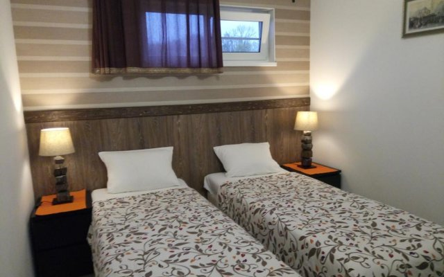 Апартаменты Берлога комната для гостей